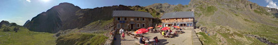 On the terrace of the La Pra refuge at 2100 m
